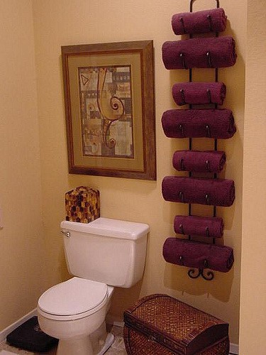 Wine racks as towel holders are the type of cool house ideas we love!